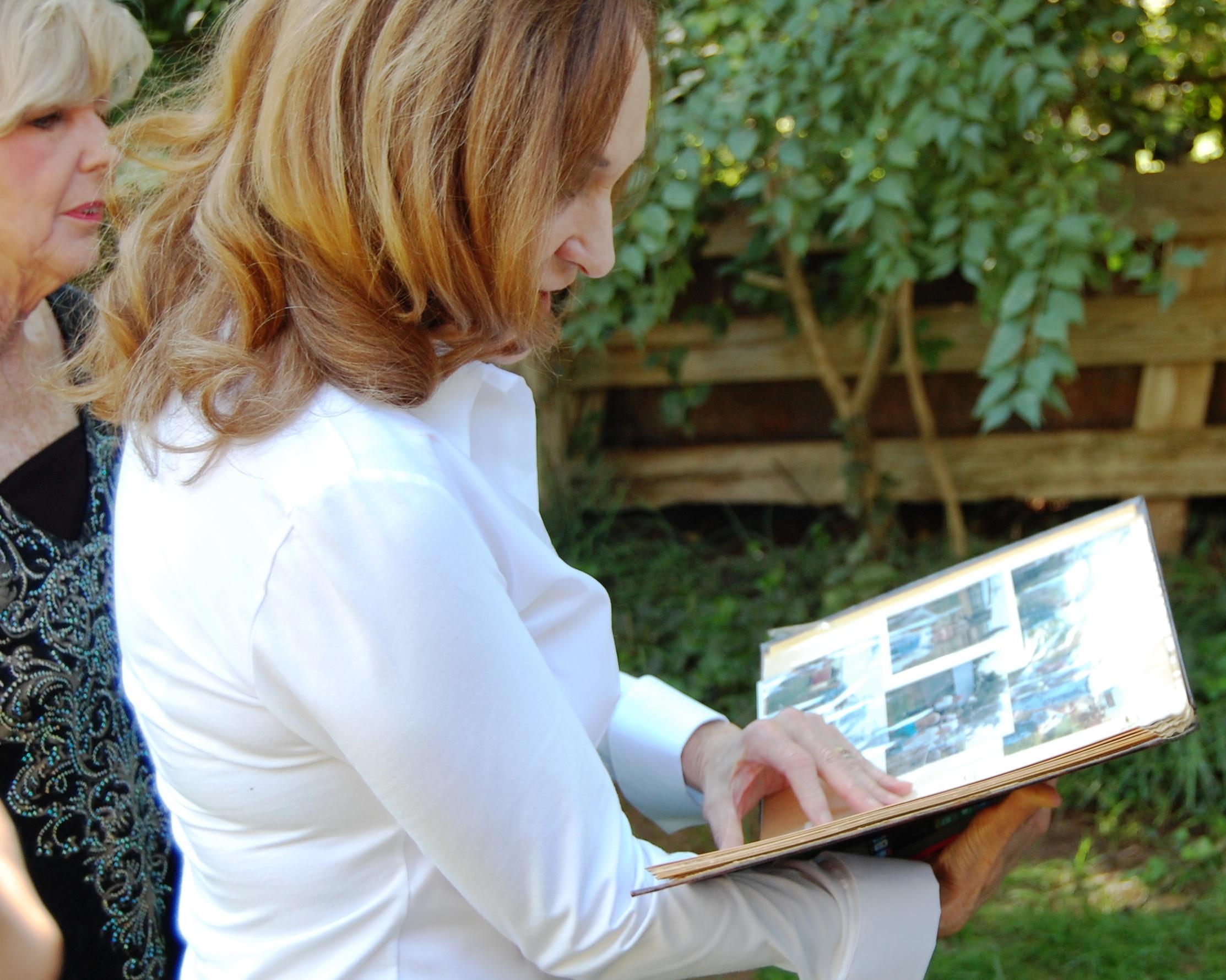Beth looking at photos